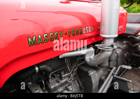 Side of a red Massey Ferguson vintage farm tractor - Stock Photo