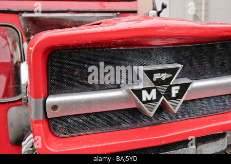 Front grille of a red vintage Massey Ferguson farm tractor - Stock Photo