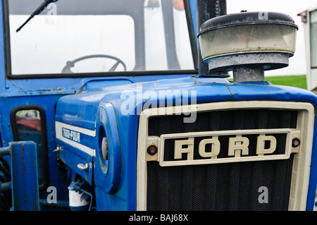 Front badge of a blue Ford vintage tractor - Stock Photo