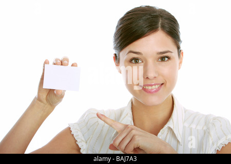 young woman holding blank business card - Stock Photo