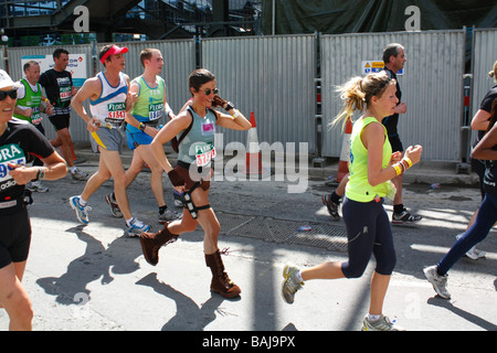 Woman dressed as Lara Croft from tomb raider. London marathon runners 26 04 09 - Stock Photo