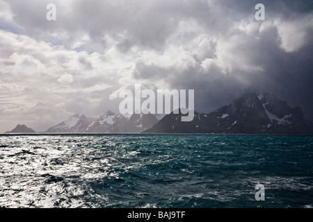 Storm clouds and sunshine near Cooper Bay South Georgia Antarctica - Stock Photo