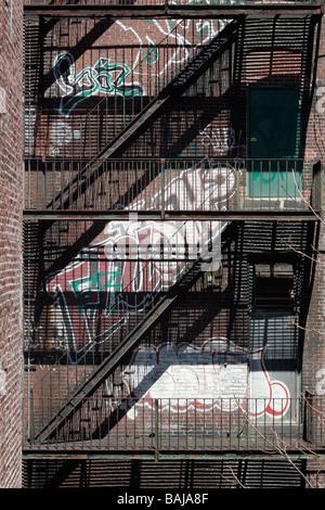 fire escape graffiti - Stock Photo