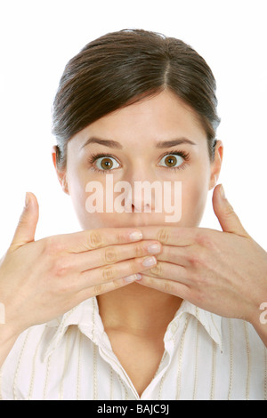 Young woman covering mouth with hand - Stock Photo