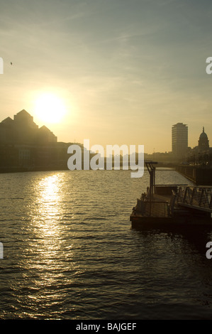 Sunset over River Liffey from the Millennium bridge, Dublin, Ireland - Stock Photo