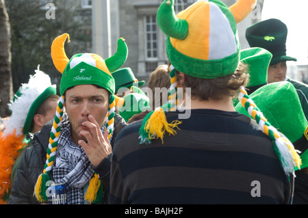 Men wearing viking hats in crowd at St Parick's Day parade, Dublin, Ireland - Stock Photo