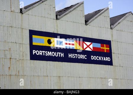 A sign on the wall of a building at Portsmouth Historic Dockyard, Hampshire, UK - Stock Photo
