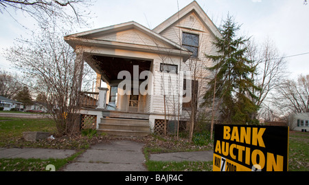 Merrill Michigan A sign advertises the upcoming bank auction of a foreclosed home in rural Michigan - Stock Photo