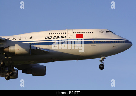 Air China Boeing 747-400 jumbo jet plane arriving at dawn. Close up view. - Stock Photo
