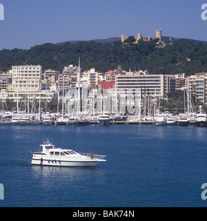 Motor Yacht en route for Palma International Boat Show 2009, with historic Bellver Castle and Paseo Maritimo in - Stock Photo