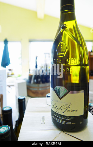 bottle with moulded relief on the neck wine shop eclat du prince le cellier des princes chateauneuf du pape rhone - Stock Photo
