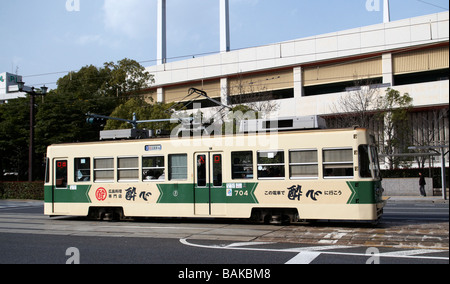Electric trams form part of the public transport system in Hiroshima, Japan - Stock Photo