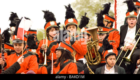 Young teenagers sitting on a float wait to perform in Chicago Polihs Parade - Stock Photo