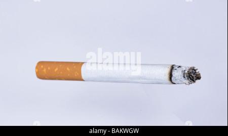 lite cigarette burning - Stock Photo