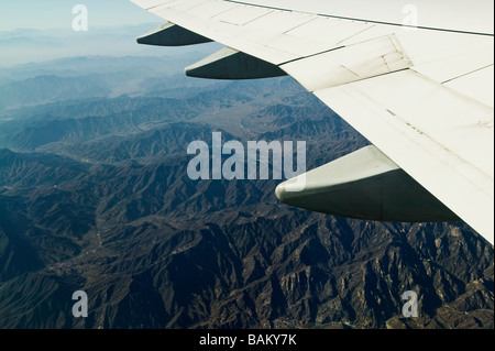 Airplane over mountains in china - Stock Photo
