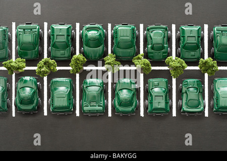 Eco cars in parking lot - Stock Photo