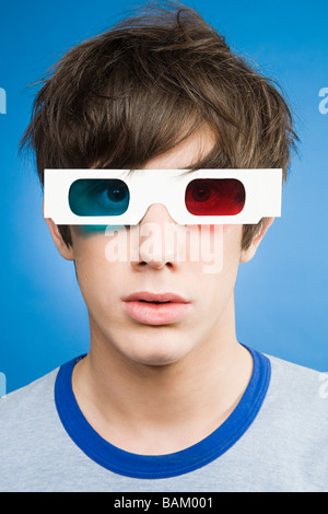 A teenage boy wearing 3d glasses - Stock Photo