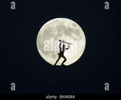 Toy soldier against full moon - Stock Photo