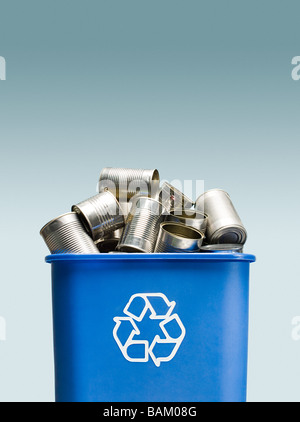 Tin cans in a recycling bin - Stock Photo