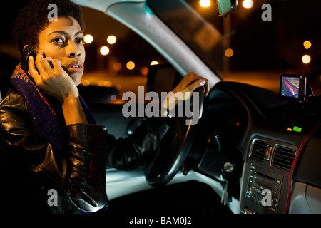 Woman on cellphone in car - Stock Photo