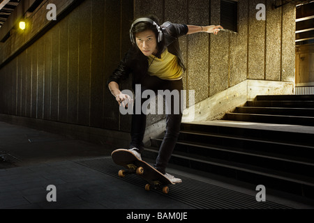 A young man skateboarding - Stock Photo