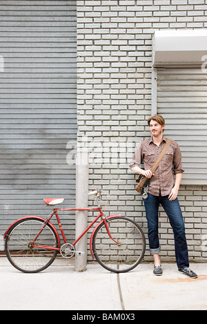 Man with bicycle - Stock Photo