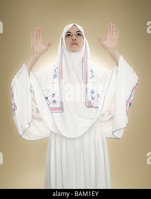 A young muslim woman praying - Stock Photo