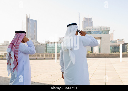 Businessmen using cell phones - Stock Photo