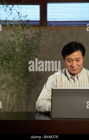 Businessman Typing On Laptop - Stock Photo