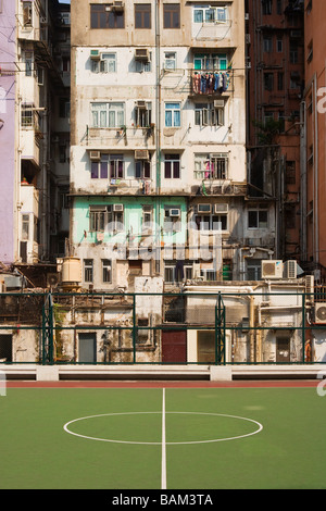 Basketball court and building in hong kong - Stock Photo