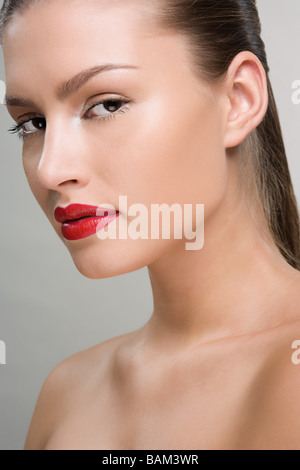 Beautiful woman wearing red lipstick - Stock Photo
