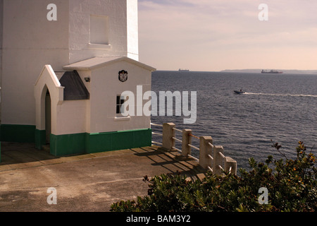 Small craft leaving Carrick Roads view from base of St Anthony's Head lighthouse Cornwall UK - Stock Photo
