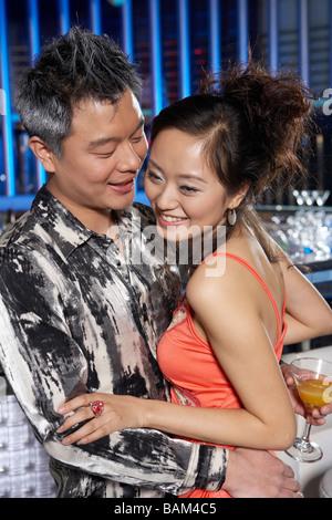 Couple Embracing In A Nightclub - Stock Photo