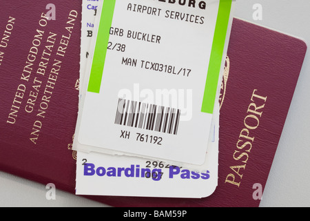 United Kingdom British passport plane flight Boarding Pass and luggage ticket for travel abroad. England UK Britain - Stock Photo