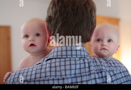 Father with twins 6 month old - Stock Photo
