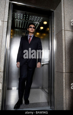 Man Walking Out Of Elevator - Stock Photo