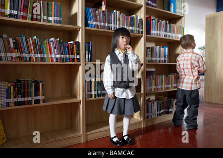 Children Standing In Library - Stock Photo
