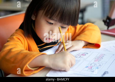 Small Girl Colouring In - Stock Photo