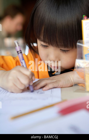 Small Girl Learning To Write - Stock Photo
