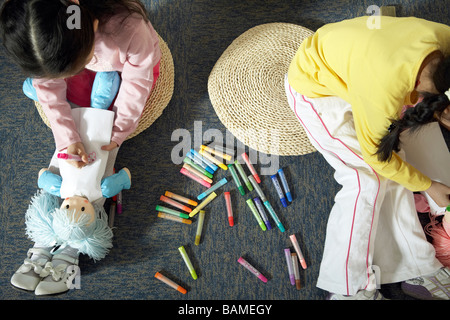 Girls Sitting In Classroom Drawing - Stock Photo