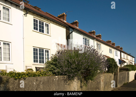 White painted terrace houses in sunlight - Stock Photo