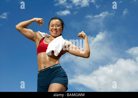 Athlete Wiping Her Face With A Towel - Stock Photo