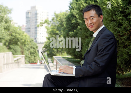 Businessman Typing On Laptop - Stock Photo