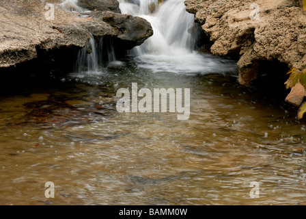 Water flows through rock, carving out interesting shapes at Turner Falls Park near Davis, Oklahoma, USA. - Stock Photo