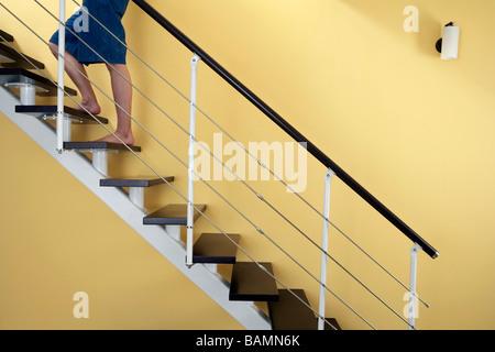 Man Walking Up Staircase - Stock Photo