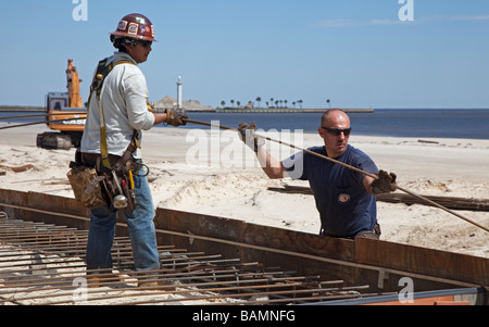 Workers Rebuild Boardwalk Destroyed by Hurricane Katrina - Stock Photo