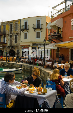 Dining by the Venetian port in old town Rethymno Crete Greece Europe - Stock Photo