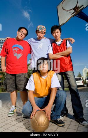 Teenage Boys Posing On A Basketball Court - Stock Photo