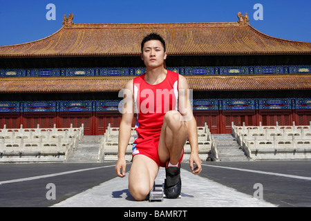 Portrait Of Athlete In Front Of Temple - Stock Photo