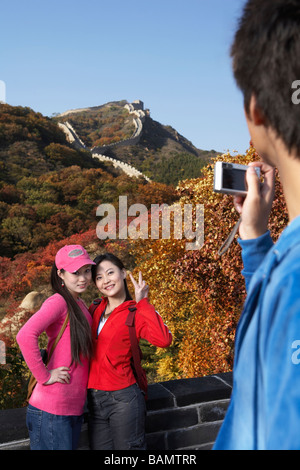Young Women Getting Their Picture Taken On The Great Wall Of China - Stock Photo